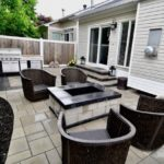 Backyard paver patio with fire pit, step system, and bbq area