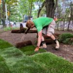 Our crew member Jason laying down the sod