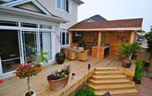 Large deck with outdoor kitchen, bar and eating area