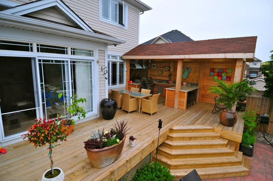 Outdoor Kitchen Design and Deck Construction By Alan's Landscaping and Heather's Gardens.