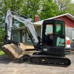Installing 4000lbs natural stone step with excavator
