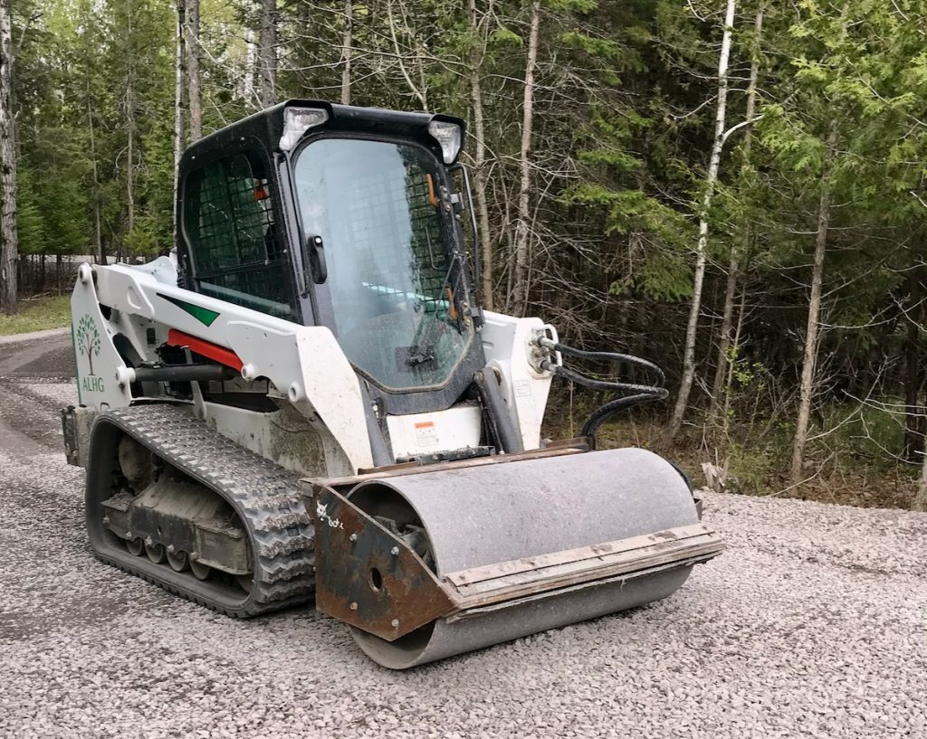Bobcat Skidsteer with compactor attachment